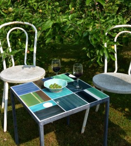 patio table with green tiles inlaid