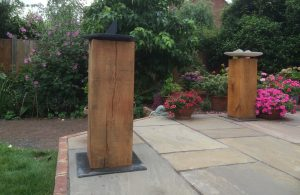oak plinth with ceramic birdbath