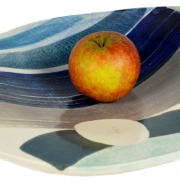 apple on ceramic bowl