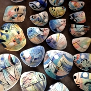 array of glazed fine art ceramic bowls by belatrova