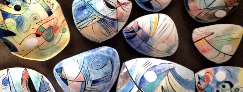 array of glazed fine art ceramic bowls by belatrova